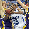 Split: Indiana State's #23, Harry Marshall drives the ball between two Northern Iowa defenders Sunday afternoon at Hulman Center.