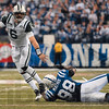 Tribune-Star/Joseph C. Garza<br /> On his heels: New York Jets quarterback Mark Sanchez tries to escape a tackle by Indianapolis defender Robert Mathis during the AFC Championship game Sunday in Indianapolis.