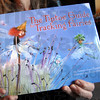 Book detail: Peggy Tierney holds one of her published books during an interview at her Terre Haute home Sunday afternoon.