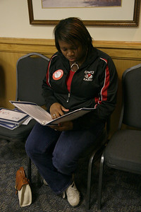 Candace Champion, senior, reviews the educational materials before donating blood.