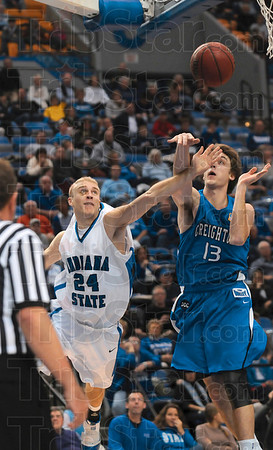 Tribune-Star/Joseph C. Garza<br /> Foul line bound: Indiana State's Jordan Printy is fouled by Creighton's Chad Millard during the Sycamores' 70-64 win Friday at Hulman Center.