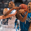 Tribune-Star/Joseph C. Garza<br /> Hang on to it, Harry: Indiana State's Harry Marshall contends with Creighton's Casey Harriman and Justin Carter as he snatches a loose ball during the Sycamores' win Friday at Hulman Center.