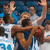 Tribune-Star/Joseph C. Garza<br /> No scoring for you: Indiana State's Harry Marshall fouls Creighton's Kenny Lawson, Jr., as he and teammate Brant Leitnaker try to stop the Jays during the Sycamores' 70-64 win Friday at Hulman Center.