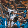 Tribune-Star/Joseph C. Garza<br /> Board crashin': Indiana State's Isiah Martin reaches for a rebound as he is surrounded by a trio of Creighton defenders during the Sycamores' win Friday at Hulman Center.