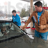 Tribune-Star/Joseph C. Garza<br /> United for a cleaner windshield: Mayor Duke Bennett and Congressman Brad Ellsworth work together to clean Dorothy Staggs' car windows Friday at Baesler's during the United Day for the United Way.