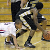 Loose ball: North's #10, Chase Jones attempts to get his hands on a loose ball during game action Friday night against Warren Central.