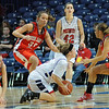 Surrounded: Patriot Danielle Ketner is surrounded by Braves Kaylee Ellis, Emily Bell(30) and Haley Seibert. Watching is North's Nicole Anderson(42).