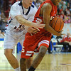 Hounded: Terre Haute North forward Chris O'Leary hounds Brave ball handler Jermaine Smith in first quarter action Friday night in the Hulman Center.