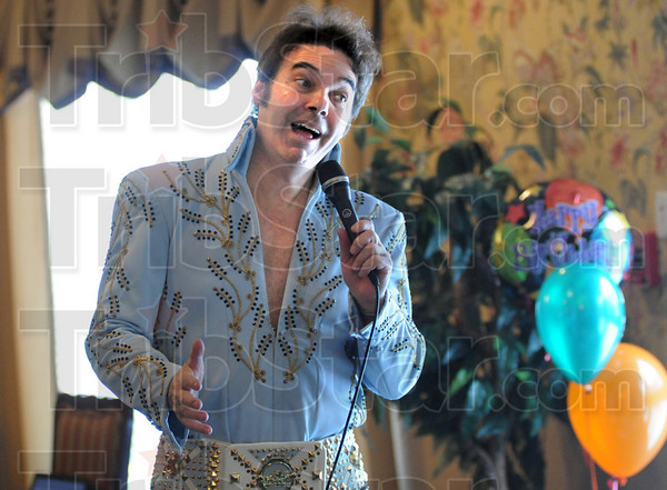 Happy Birthday: Bruce Borders performs as Elvis on the 75th birthday of the icon at Cobblestone Crossings Health Campus Friday afternoon.