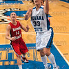 Tribune-Star/Joseph C. Garza<br /> Drive and score: Indiana State's Kelsey Luna drives through the Illinois State defense to score as Illinois State's Amanda Clifton looks on Friday during the Sycamores' game against the Redbirds at Hulman Center.