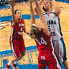 Tribune-Star/Joseph C. Garza<br /> A struggle to score: Indiana State's Shannon Thomas contends with Illinois State's Amanda Clifton as she shoots for two points while Illinois State's Ashleen Bracey, left, closes in during the Sycamores' loss Friday at Hulman Center.