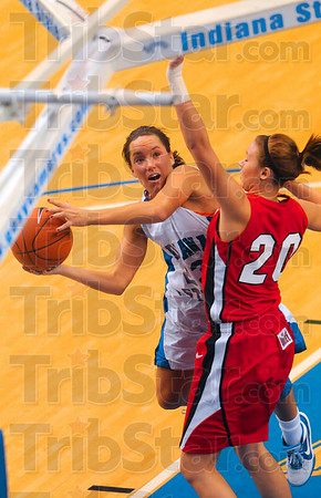 Tribune-Star/Joseph C. Garza<br /> Working her shot inside: Indiana State's Taylor Whitley works against Illinois State's Katie Broadway inside the paint during the Sycamores' game against the Redbirds Friday at Hulman Center.
