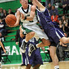 Controlled: West Vigo's #5, Tyler Wampler drives the ball down the lane and scores against a Greencastle defender during first half action Saturday night.