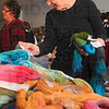 Tribune-Star/Joseph C. Garza<br /> Choosing the colors for her palette: Zann Carter looks through the various colors and types of yarn for her knitting project in Judy Ditmore's lace knitting class Saturday, Jan. 9 at River Wools.