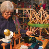Tribune-Star/Joseph C. Garza<br /> For the knitters: River Wools owner Martha Crossen prepares a ball of multi-colored yarn for Judy Ditmore's lace knitting class Saturday at the Wabash Avenue yarn store.