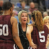 Time out: Saluki coach Missy Tiber exhorts her team during a first half timeout.
