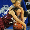 Mine: Saluki guard Christine Presswood(1) fights for control of the ball with ISUs Deja Mattox in first half action Saturday afternoon in Hulman Center.