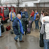 Ready: Travelers prepare to load into vans as they start their trip to Asuchwitz with Eva Kor Saturday morning.