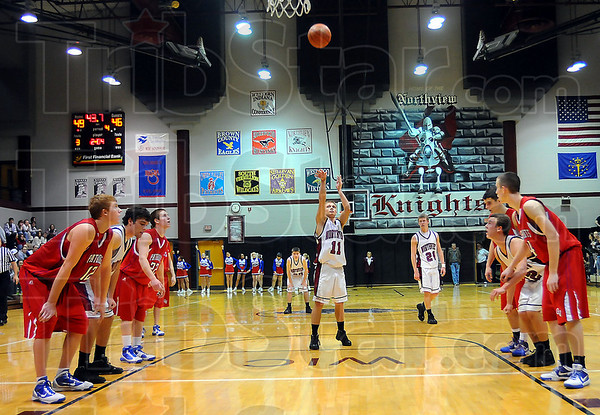 Game on the line: With Northview holding a slim lead in the last minute, Owen Valley had no choice but to start fouling when the Knights went into a stall. Here Damon Hyatt tries to add to teh margin.