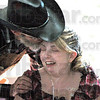 Cowboy kiss: Carl Compton kisses Sierra Cooper Saturday afternoon at a fundraiser for her. He's a member of the Country Music Makers band. They are one of three bands playing during the event.