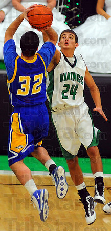 In your face: Viking defender Brodey McCalister applies pressure on Mustang shooter Tanner Pierce(32) in first half action Friday night in the West Vigo gym.