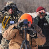 Room with a view: Eagle watchers Jim Whited, John Pike and Mark Wunderlich take watch eagles near the Cayuga Generating Station Satureday afternoon.