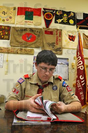 Prepared: Dakota Gaskins looks through his scout manual preparing for the Klondike weekend at Camp Wildwood. Troop 311 meets upstairs in the VFW post 972.