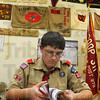Prepared: Dakota Gaskins looks through his scout manual preparing for the Klondike weekend at Camp Wildwood. Troop 311 meets upstairs in the VFW post 972.