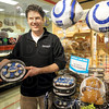 Colts food: Casey Baesler holds  some of the Colts snacks that are being produced in the store's bakery.