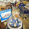Colts snacks display: Baesler's Market shopper Jennifer Baker walks through the bakery area while shopping Friday afternoon.