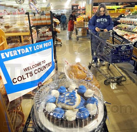 Colts snacks display: Baesler's Market shopper Jennifer Baker walks through the bakery area while shopping Friday afternoon.