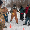 Tribune-Star/Joseph C. Garza<br /> Guided by voices: Boy Scout Seth Boland, center, of Troop 30 attempts to complete a figure eight while blindfolded with the help of his fellow scouts during one of the Olympics-inspired challenges of the Klondike Derby at Camp Wildwood Saturday.