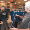 Tribune-Star/Joseph C. Garza<br /> Shopping for Super Bowl attire: Milisa Carty shares a laugh with her husband, Jody Carty, as they shop for Indianapolis Colts attire Thursday at J.C. Penney's in the Honey Creek Mall.