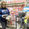 Snacks: Colts fan Jennifer Baker shops for snacks at Baesler's Market Friday afternoon. She's looking at the snacks produced in the bakery with a Colts theme.
