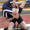 Dumped: South wrestler Tsali Lough dumps his opponent during Wednesday night's North/South wrestling match.