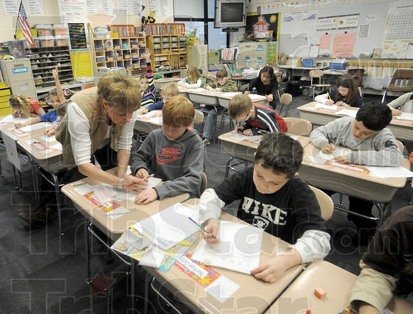 Class: Dixie Bee Elementary School third grade teacher Dianna Lammey works with her students Wednesday afternoon.