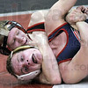 Wrapped up: Terre Haute South's P.J. Montgomery (top) controls his North counterpart Chris Hayden during Wednesday's 140 lb. matchup of the North/South wrestling meet. Montgomery won the match.