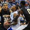 Not here: Sycamore guard Harry Marshall is fouled by Wichita State's Aaron Ellis while teammate Bryce Maves helps defend.