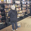 Search: Vigo Co. Public Library patrons search for books Wednesday afternoon.