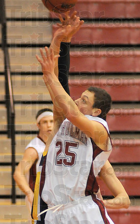 Touchy situation: Rose-Hulman's Austin Weatherford has the ball and his hand tipped by a Franklin defender in first half action Wednesday night.