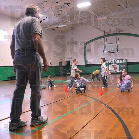 Well usaed: The West Vigo Community Center was one of the organizations that benefited from the First Financial Bank Trust Distribution Wednesday. Here Chuck Linder of Americorp leads children in an after-school competition.