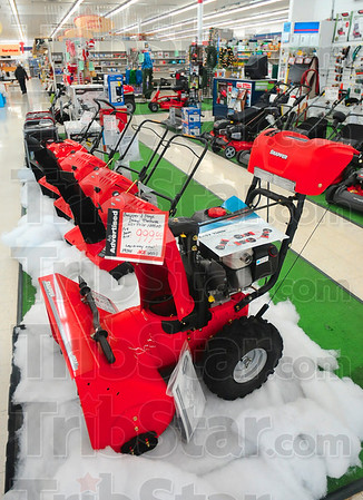Tribune-Star/Joseph C. Garza<br /> It'll move the fluffly stuff: A row of snow blowers sit ready in Paitson Brothers Ace Hardware Wednesday to move any snow that will cover the Wabash Valley.