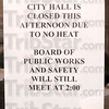 A sign alerts visitors to City Hall Monday that the heat is out in the facility.