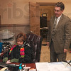 Tribune-Star/Joseph C. Garza<br /> Tell 'em to bring the heat: Mayor Duke Bennett and secretary Genie Pearson discuss the plans to fix the heating unit in City Hall Monday.