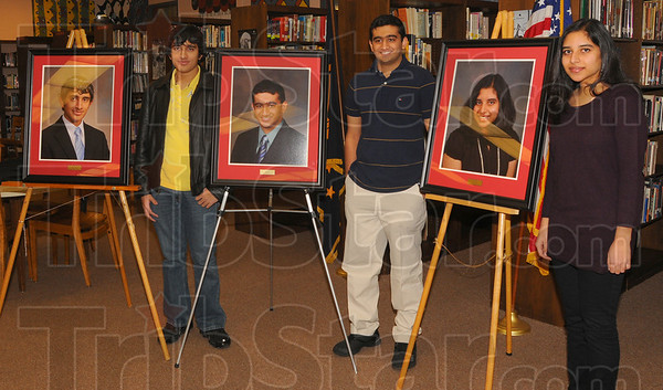 Honored: Three Terre Haute South Vigo High School students were recognized for their academic achievements Monday afternoon at their school. Last year Sachin Schinde recieved the title of Indiana Mr. Math while Raj Bhuptani won Mr. Science. In 2007-08 Swara Kopparty recieved the top science award.