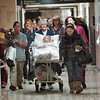 Into the new: Union Hospital patient Mary Kay Shull leaves the old hospital to become the first official patient to arrive at the new facility Tuesday morning.