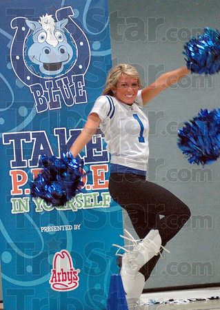 Cheer: A Colts cheerleader performs for West Vigo Elementary School kids Tuesday morning as part of the P.R.I.D.E. program.