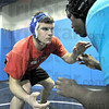 Wrestler: Terre Haute North's David Knight (L) works out with teammate Jordan Robinson during Tuesday's team practice.