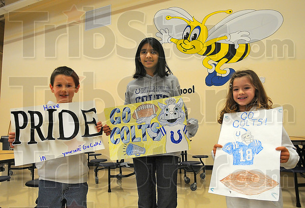 Top posters: Landon Carre, Madhura Prabhudesai and Arwen Wroblewski were the top vote getters in the Dixie Bee Elementary School poster contest. Fellow students cast votes with quarters which totaled $1,000 which went to disaster relief in Haiti.