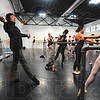 Tribune-Star/Joseph C. Garza<br /> Demonstration: Taylor Twiggs, right, watches and performs a move with her fellow Academy of Dance students as taught by former Bolshoi Ballet member, Sergei Radchenko, left, Tuesday at the academy on Third Street.